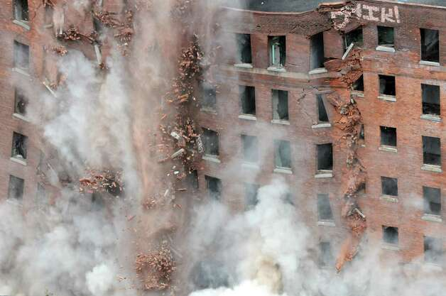 The 11-story Wellington Annex on Howard St. is imploded Saturday morning, Aug. 23, 2014, to make way for Albanya€™s new convention center in Albany, N.Y. (Will Waldron/Times Union) Photo: WW / 00028210B