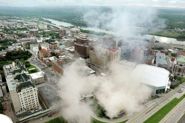 The dust begins to settle on the city following the implosion of Wellington Annex on Saturday, Aug. 23, 2014, in Albany, N.Y. (Cindy Schultz / Times Union) Photo: Cindy Schultz / 00028210C