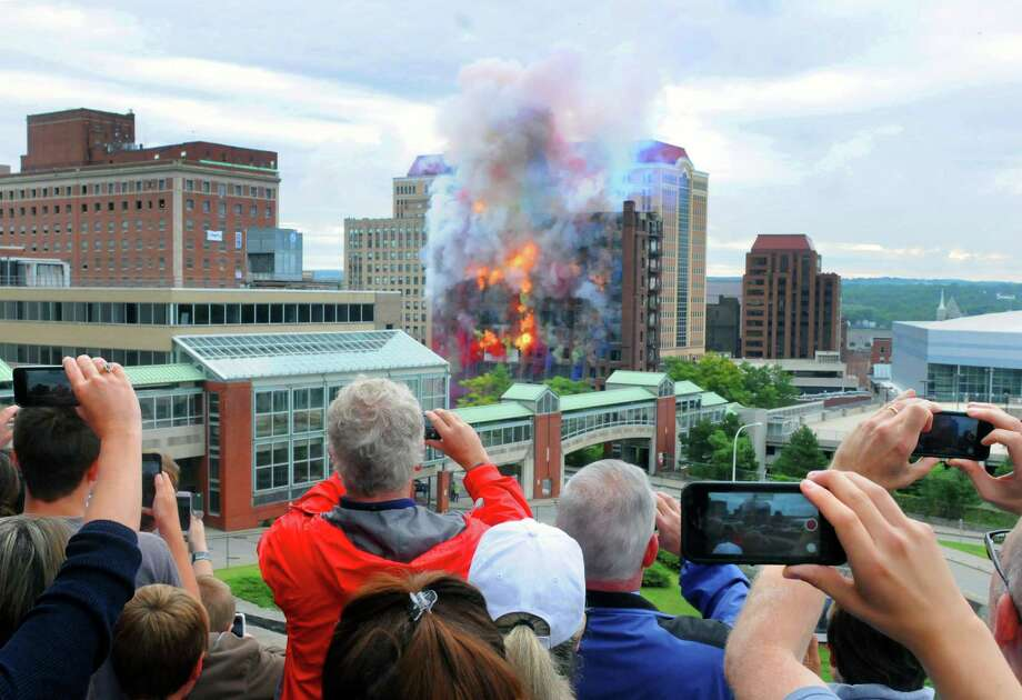 Keep clicking to view photos from the implosion of the Wellington Hotel and the construction of the Albany Capital Center.Spectators watch from the Empire State Plaza, below the Egg, as the Wellington Annex is imploded to make way for the new Capital Center on Saturday Aug. 23, 2014 in Albany, N.Y. (Michael P. Farrell/Times Union) Photo: Michael P. Farrell / 00028210A