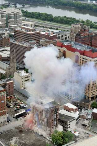The Wellington Annex begins to crumble during an implosion on Saturday, Aug. 23, 2014, in Albany, N.Y. (Cindy Schultz / Times Union) Photo: Cindy Schultz / 00028210C