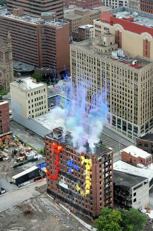 Initial explosives are lit on the Wellington Annex during an implosion on Saturday, Aug. 23, 2014, in Albany, N.Y. (Cindy Schultz / Times Union) Photo: Cindy Schultz / 00028210C