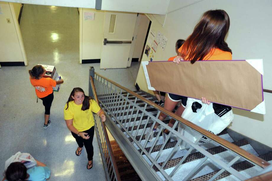 Resident assistant Allee Von Stackelberg, lower center, keeps the move in moving as incoming students move into their dorms at The College of Saint Rose on Saturday Aug. 23, 2014 in Albany, N.Y. (Michael P. Farrell/Times Union) Photo: Michael P. Farrell / 00028228A