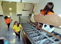 Resident assistant Allee Von Stackelberg, lower center, keeps the move in moving as incoming students move into their dorms at The College of Saint Rose on Saturday Aug. 23, 2014 in Albany, N.Y. (Michael P. Farrell/Times Union)
