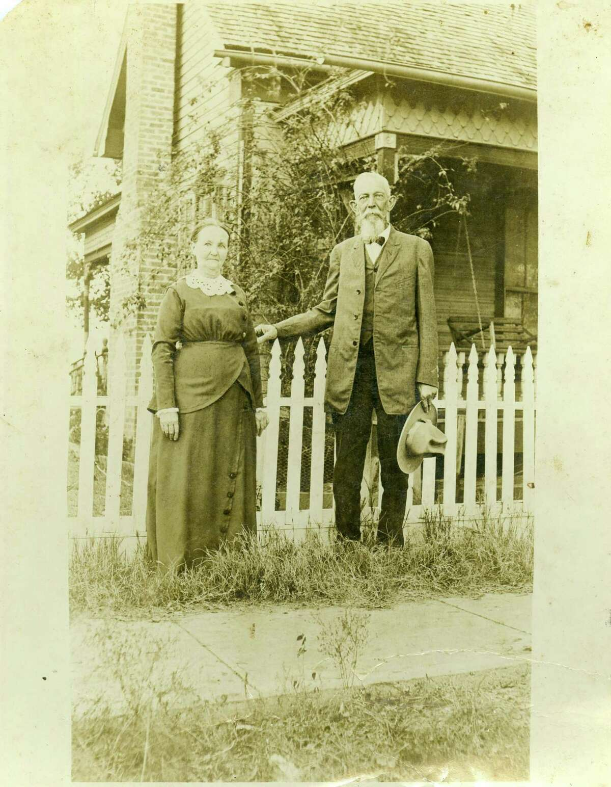 Augustus and Lizzie Landrum Tomlinson stand outside their home in Lott, Texas, circa 1925. He was the son of James K. Tomlinson, founder of the Tomlinson Hill plantation.