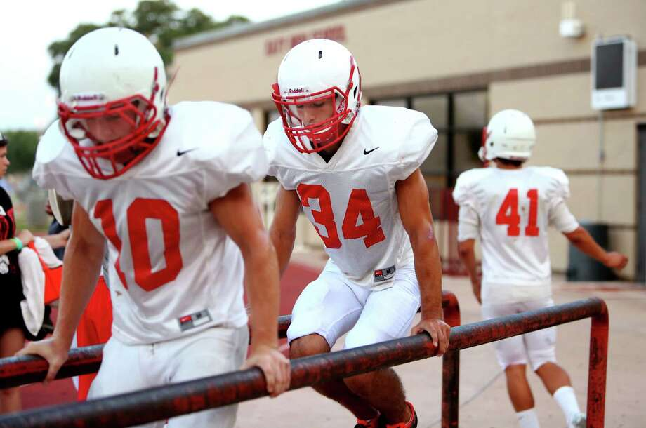 Colby Anthony (10), Cody Copeland (34) and Austin Luna (41) do conditioning drills at Katy High School fall football practice first day of full pads Friday, Aug. 15, 2014, in Katy, Texas.HoustonChronicle.com series: Katy football: A portrait of a powerhouse Photo: Gary Coronado, Houston Chronicle / © 2014 Houston Chronicle