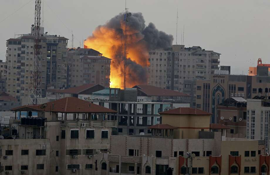 Fire and smoke rise from the 12-story, 44-apartment Zafer tower after an Israeli air strike  in an upscale part of downtown Gaza City. Twenty-two people were reported wounded. Photo: Adel Hana, Associated Press