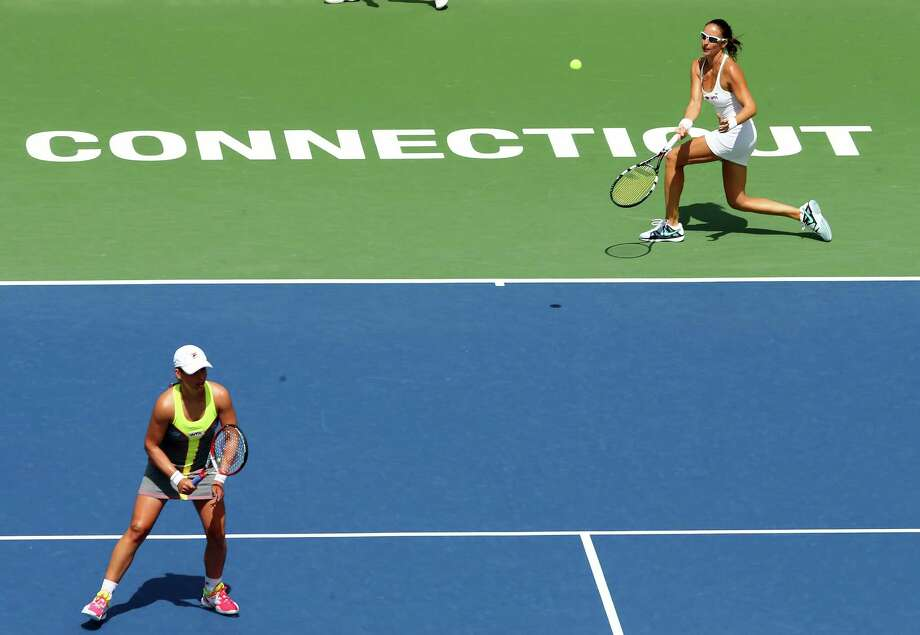 NEW HAVEN, CT - AUGUST 23:  Arantxa Parra Santonja of Spain chases down a shot as teammate Marina Erakovic of New Zealand looks on during their match against Andreja Klepac of Slovenia and Silvia Soler-Espinosa of Spain during the doubles final during the Connecticut Open at the Connecticut Tennis Center at Yale on August 23, 2014 in New Haven, Connecticut.The team of Klepac and Soler-Espinosa defeated Parra Santonja and Erakovic 7-5,4-6,[10-7] Photo: Elsa, Getty Images / 2014 Getty Images