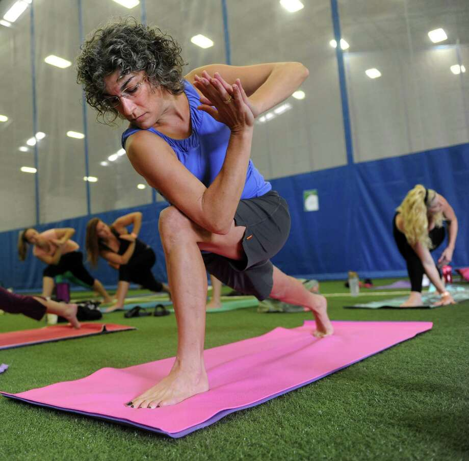 Diana Veneri, of Prospect, takes a Vinyasa Flow class Saturday, Aug. 23, 2014  at the Newtown Yoga Festival, to benefit the community fund of the Sandy Hook Promise Foundation. Photo: Autumn Driscoll / Connecticut Post