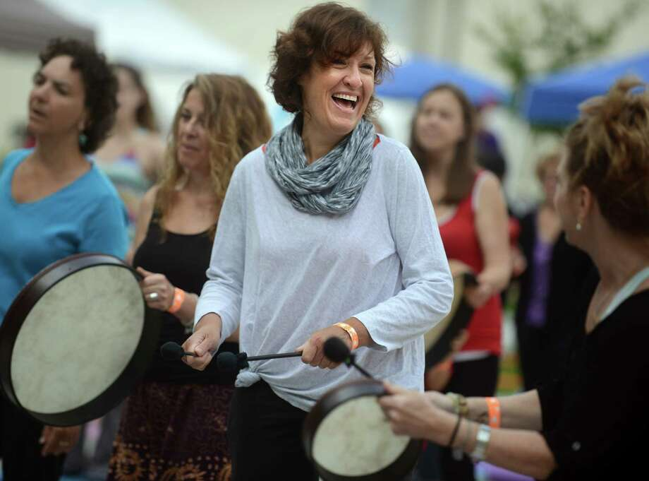 Sally Murac, of Newington, participates in a drumming circle Saturday, Aug. 23, 2014 at the Newtown Yoga Festival, to benefit the community fund of the Sandy Hook Promise Foundation. Photo: Autumn Driscoll / Connecticut Post