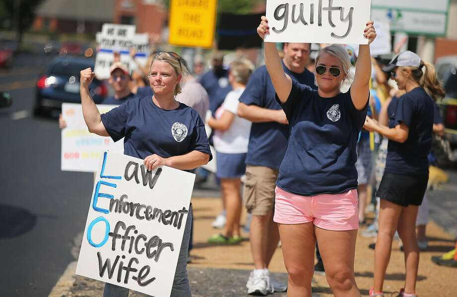 Supporters of police Officer Darren Wilson rally  in St. Louis. Tensions subsided in Ferguson, Mo. Photo: Scott Olson, Getty Images