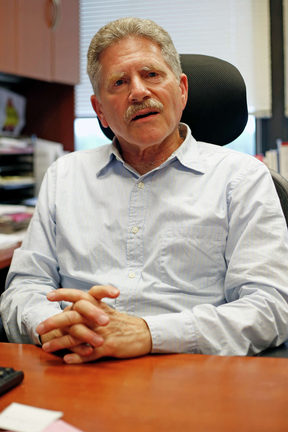 Bob Freeman sits at his desk on Friday, August 15, 2014 in Albany, N.Y. (Tom Brenner/ Special to the Times Union)