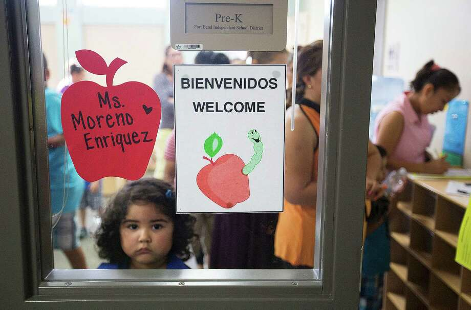 Calin Pineda, 4, waits to meet her teacher, during a meet the teacher event at Fort Bend ISD's Ridgemont Early Childhood Center Thursday, Aug. 21, 2014, in Houston. Photo: Johnny Hanson, Houston Chronicle / © 2014  Houston Chronicle
