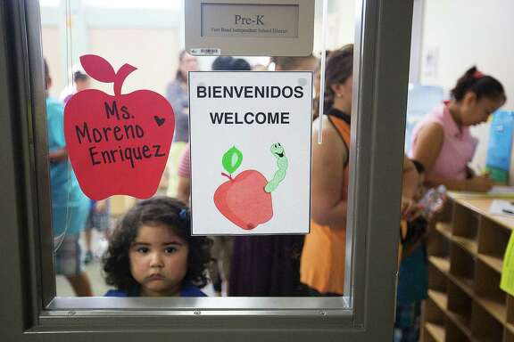 Calin Pineda, 4, waits to meet her teacher, during a meet the teacher event at Fort Bend ISD's Ridgemont Early Childhood Center Thursday, Aug. 21, 2014, in Houston.