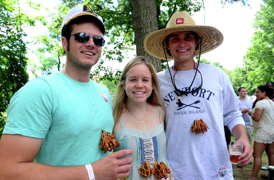 Friends Tim O'Neill, of New Haven, left, Kristen Jenkins, NYC, and Matthew Stebbins, of Stratford, enjoy the Shakesbeer Festival held on the grounds of the American Shakespeare Festival Theater in Stratford, Conn. on Saturday August 23, 2014. The festival showcases fine craft beers from around Connecticut as well as nearby states. Photo: Christian Abraham / Connecticut Post