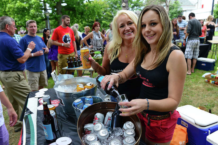 Tonya Plefka and coworker Lisa Shehu, right, with Narraganset Brewing Company, serve their samples to guests at the Shakesbeer Festival held on the grounds of the American Shakespeare Festival Theater in Stratford, Conn. on Saturday August 23, 2014. The festival showcases fine craft beers from around Connecticut as well as nearby states. Photo: Christian Abraham / Connecticut Post
