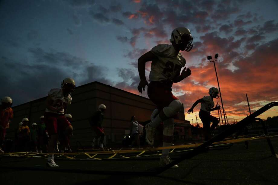 Players take part in conditioning during Katy's first day of practice Aug. 11. These Tigers are taking the first steps to what they hope is another title run. Photo: Gary Coronado, Staff / © 2014 Houston Chronicle