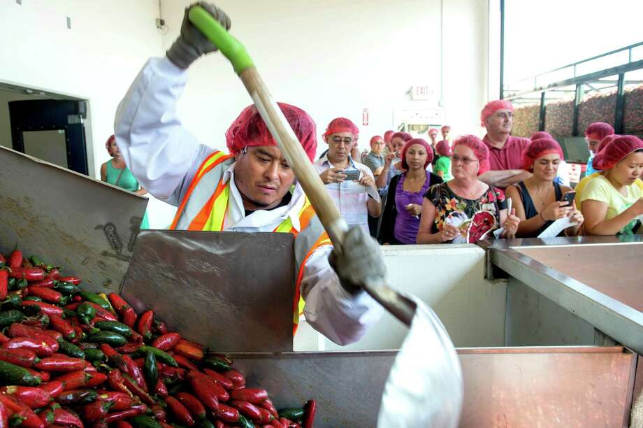 Huy Fong Foods, which produces Sriracha hot sauce, opened its doors to tours this weekend. During the 20-minute walk, visitors were able to watch the chili grinding process, sample Sriracha-flavored treats and visit the new gift shop. Photo: Watchara Phomicinda, MBR / San Gabriel Valley Tribune