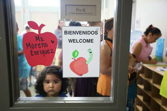 Calin Pineda, 4, waits to meet her teacher during an event at Fort Bend Independent School District's Ridgemont Early Childhood Center ahead of the school year starting on Monday.