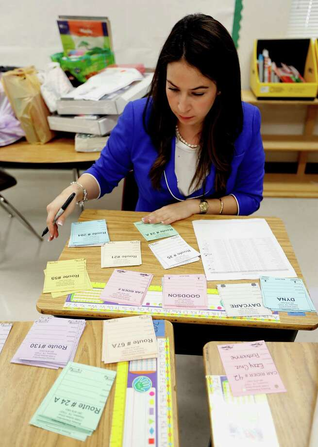 Aldine Independent School District bilingual teacher Pamela Pontvianne, who relocated from the Valley, works in her new classroom at Bussey Elementary. Photo: James Nielsen, Staff / © 2014  Houston Chronicle