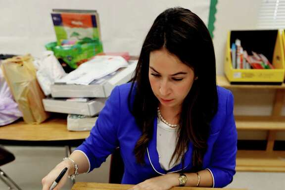 Aldine Independent School District bilingual teacher Pamela Pontvianne, who relocated from the Valley, works in her new classroom at Bussey Elementary.