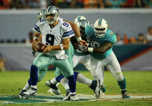 Dallas Cowboys quarterback Tony Romo (9) runs with the ball during the first half of an NFL preseason football game against the Miami Dolphins, Saturday, Aug. 23, 2014 in Miami Gardens, Fla. (AP Photo/J Pat Carter) Photo: J Pat Carter, Associated Press / AP