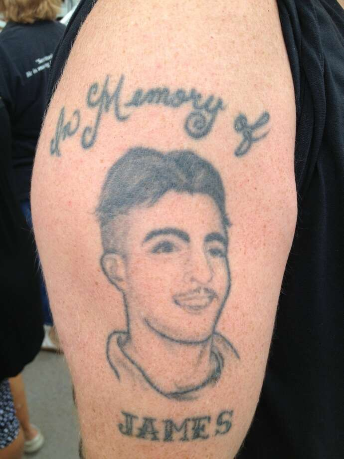 "Tattoo of James Conte, who was murdered at age 19 in Bushwick, Brooklyn on June 8, 1997. His best friend, Eric Lutz, wore the tattoo and carried a sign, ""Today Is V.E. Day."" Lutz and friends bet V.E. Day in honor of their dead friend, whose graffiti tag was V.E. The horse was an upset winner, beating Wicked Strong by a nose at the wire. (Paul Grondahl/Times Union)"