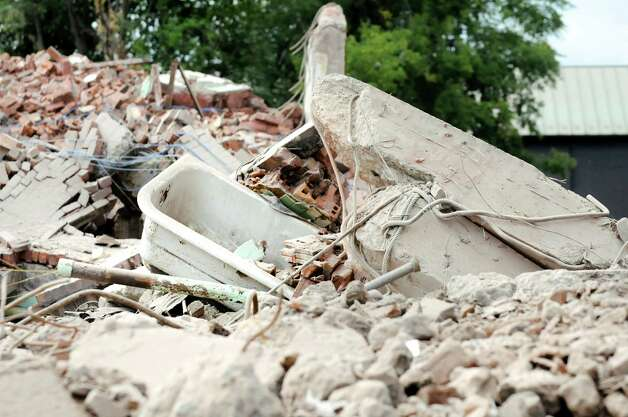 A bathtub stands out from the rubble following an implosion of the Wellington Annex on Saturday, Aug. 23, 2014, in Albany, N.Y. (Cindy Schultz / Times Union) Photo: Cindy Schultz / 00028210C