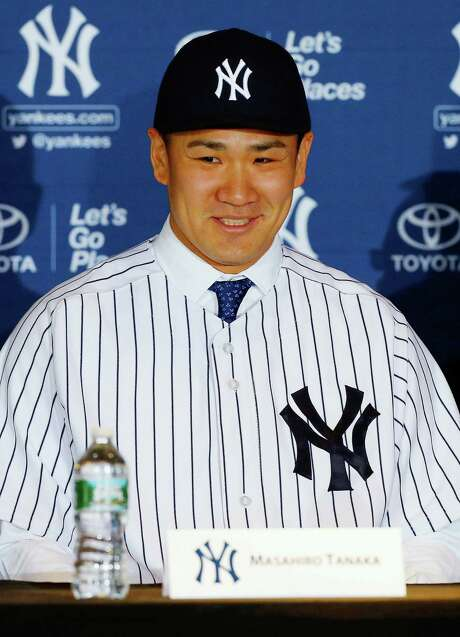 NEW YORK, NY - FEBRUARY 11:  Masahiro Tanaka of the New York Yankees smiles as he is introduced to the media during a news conference on February 11, 2014 at Yankee Stadium in the Bronx borough of New York City.  (Photo by Jim McIsaac/Getty Images) Photo: Jim McIsaac, Stringer / 2014 Getty Images