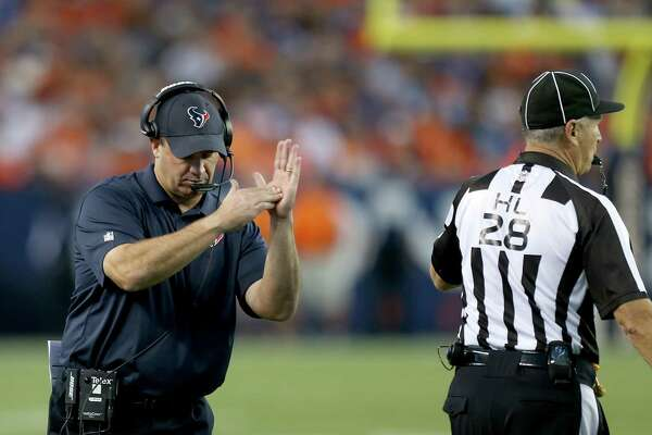 Houston Texans head coach Bill O'Brien signals for a timeout during the first quarter of an NFL preseason football game against the Denver Broncosat Sports Authority Field at Mile High on Saturday, Aug. 23, 2014, in Denver.