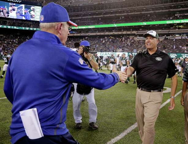 New York Jets head coach Rex Ryan, right, greets New York Giants head coach Tom Coughlin after a preseason NFL football game, Friday, Aug. 22, 2014, in East Rutherford, N.J.  The Giants won 35-24. (AP Photo/Julio Cortez)  ORG XMIT: ERU134 Photo: Julio Cortez / 1DX