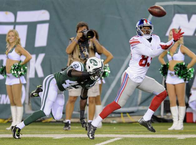 New York Giants wide receiver Preston Parker (83) reaches to catch a touchdown pass against New York Jets cornerback Brandon Dixon (42) in the third quarter of a preseason NFL football game, Friday, Aug. 22, 2014, in East Rutherford, N.J. (AP Photo/Bill Kostroun)  ORG XMIT: ERU125 Photo: Bill Kostroun / FR51951 AP