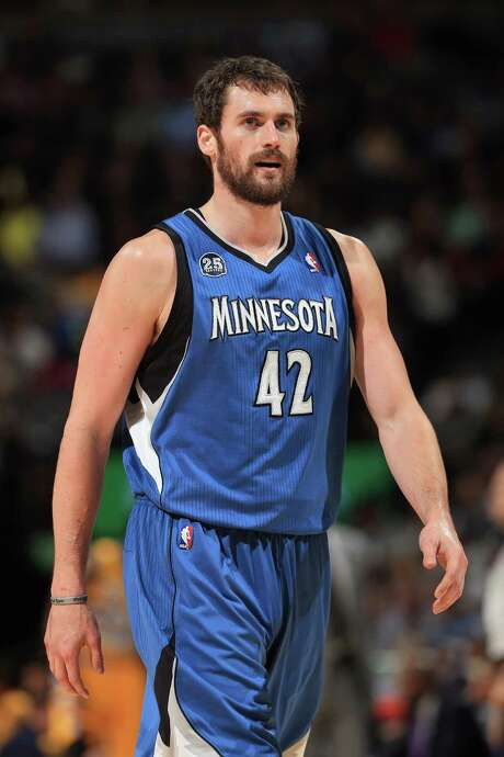 FILE - AUGUST 22, 2014: According to sources, the Minnesota Timberwolves will acquire Thaddeus Young from the Philadelphia 76ers in a deal that will send Kevin Love to the Cleveland Cavaliers in exchange for first overall pick Andrew Wiggins. DENVER, CO - NOVEMBER 15:  Kevin Love #42 of the Minnesota Timberwolves heads upcourt against the Denver Nuggets at Pepsi Center on November 15, 2013 in Denver, Colorado. The Nuggets defeated the Timberwolves 117-113. NOTE TO USER: User expressly acknowledges and agrees that, by downloading and or using this photograph, User is consenting to the terms and conditions of the Getty Images License Agreement.  (Photo by Doug Pensinger/Getty Images) Photo: Doug Pensinger, Staff / 2013 Getty Images