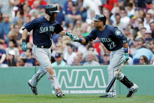 Seattle Mariners' Dustin Ackley, left, celebrates his three-run home run with Robinson Cano during the fourth inning of a baseball game against the Boston Red Sox in Boston, Saturday, Aug. 23, 2014. (AP Photo/Michael Dwyer) ORG XMIT: MAMD107 Photo: Michael Dwyer / AP