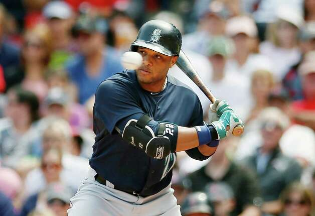 Seattle Mariners' Robinson Cano watches a high pitch during the first inning of a baseball game against the Boston Red Sox in Boston, Saturday, Aug. 23, 2014. (AP Photo/Michael Dwyer) ORG XMIT: MAMD103 Photo: Michael Dwyer / AP