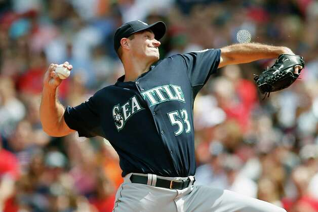 Seattle Mariners' Chris Young pitches during the first inning of a baseball game against the Boston Red Sox in Boston, Saturday, Aug. 23, 2014. (AP Photo/Michael Dwyer) ORG XMIT: MAMD102 Photo: Michael Dwyer / AP