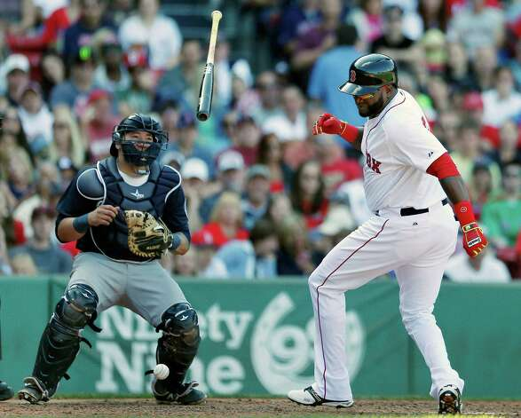 Boston Red Sox's David Ortiz, right, twists and releases his bat beside Seattle Mariners' Jesus Sucre after being hit by a pitch during the sixth inning of a baseball game in Boston, Saturday, Aug. 23, 2014. (AP Photo/Michael Dwyer) ORG XMIT: MAMD108 Photo: Michael Dwyer / AP