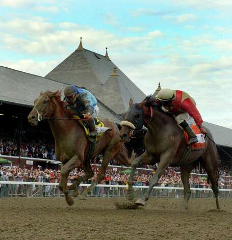 V.E. Day with jockey Javier Castellano, left, beats Wicked Strong with jockey Rajiv Maragh, right to the wire Saturday afternoon Aug. 23, 2014,  in the 145th running of the Travers at the Saratoga Race Course in Saratoga Springs, N.Y.       (Skip Dickstein/Times Union) Photo: SKIP DICKSTEIN