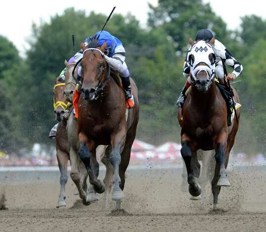 #7 The Big Beast, left with jockey Javier Castellano duels to the finish with #6 Fast Anna with jockey John Velazquez, right to win the 30th running of The Ketel One Kings's Bishop Aug. 23, 2014,  at the Saratoga Race Course in Saratoga Springs, N.Y.       (Skip Dickstein/Times Union) Photo: SKIP DICKSTEIN