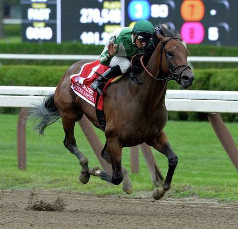 Artemis Agrotera with jockey Rajiv Maragh in the saddle wins the 36th running of The Ballerina Aug. 23, 2014,  at the Saratoga Race Course in Saratoga Springs, N.Y.       (Skip Dickstein/Times Union) Photo: SKIP DICKSTEIN