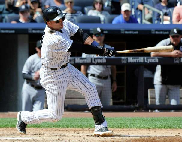 New York Yankees' Martin Prado hits a two-RBI double during the fourth inning of a baseball game against the Chicago White Sox, Saturday, Aug. 23, 2014, at Yankee Stadium in New York. (AP Photo/Bill Kostroun) ORG XMIT: NYY117 Photo: Bill Kostroun / FR51951 AP