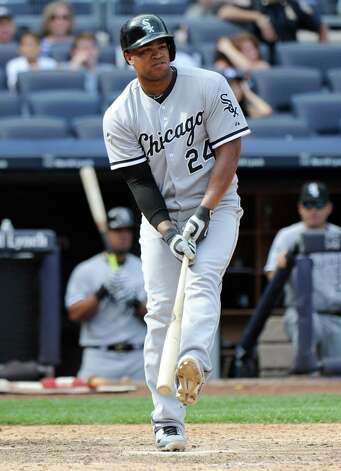 Chicago White Sox pinch hitter Dayan Viciedo reacts after striking out during the ninth inning of a baseball game against the New York Yankees Saturday, Aug. 23, 2014, at Yankee Stadium in New York. The Yankees won 5-3. (AP Photo/Bill Kostroun) ORG XMIT: NYY119 Photo: Bill Kostroun / FR51951 AP