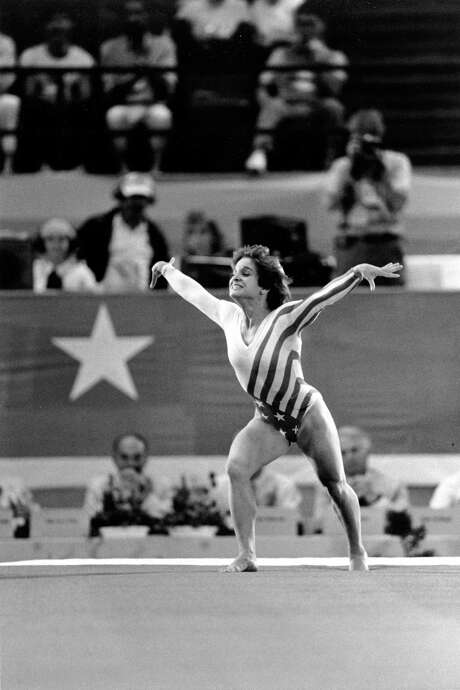 Mary Lou Retton burst onto the international gymnastics scene at the 1984 Olympics in Los Angeles, when she won the individual all-around gold medal. She says that 1984 team set the standard for U.S. gymnasts. Photo: LIONEL CIRONNEAU, STF / AP