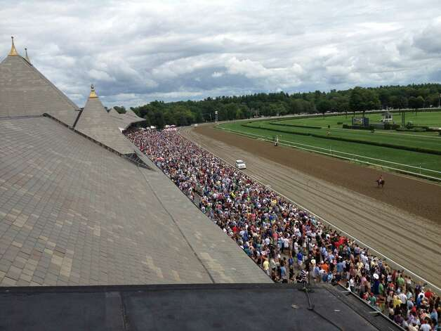 And here is the aerial view — well from the roof of the press box — of some of the crowd of 46,557 who came out to Saratoga to witness the 145th running of the Travers Stakes. It wasn't a hot day at all, in fact it was almost autumn cool, but the people who stuck around all day got to see a fantastic finish in the Midsummer Derby. (Tim Wilkin / Times Union)