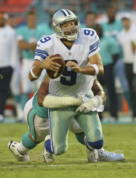 Cowboys quarterback Tony Romo played the first half of Saturday night's preseason game against the Dolphins, taking three sacks in a 25-20 defeat. Photo: Mike Ehrmann, Staff / 2014 Getty Images