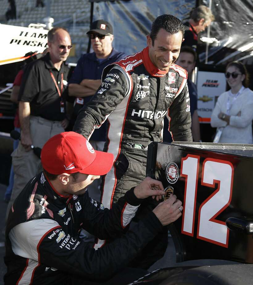 Will Power (front left) is congratulated by teammate Helio Castroneves after capturing the pole at Sonoma Raceway. Photo: Eric Risberg, Associated Press