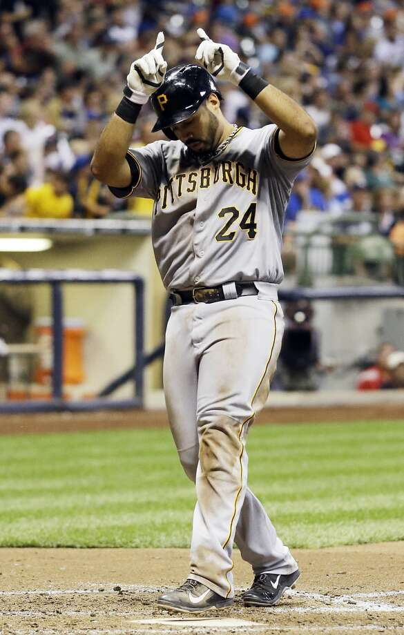 Pittsburgh's Pedro Alvarez celebrates his fifth-inning home run, a solo shot that was his second homer of the day. Photo: Morry Gash, Associated Press
