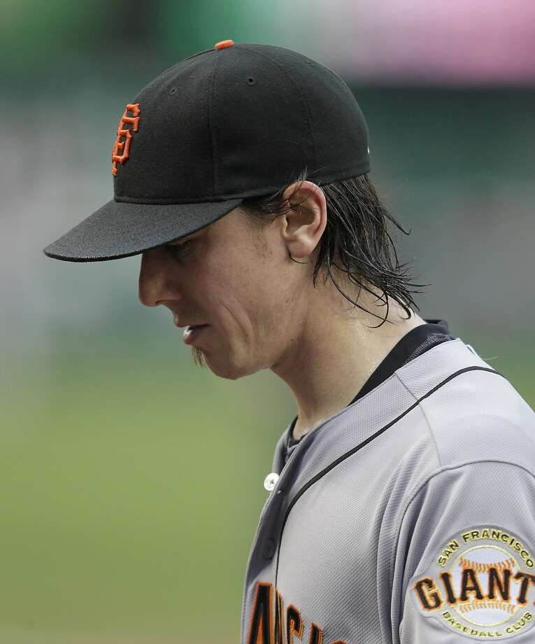 San Francisco Giants pitcher Tim Lincecum walks to the dugout after being taken out of a baseball game against the Washington Nationals during the third inning, Saturday, Aug. 23, 2014, in Washington. The Nationals won 6-2.  (AP Photo/Luis M. Alvarez) Photo: Luis M. Alvarez, Associated Press