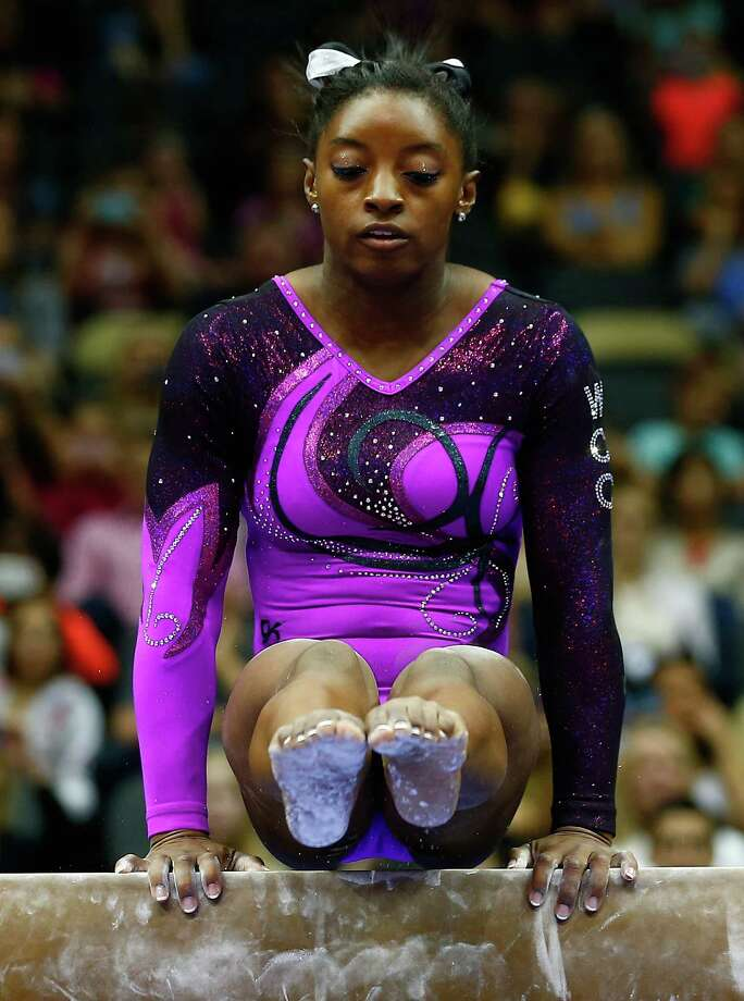 PITTSBURGH, PA - AUGUST 23:  Simone Biles competes on the balance beam in the senior women finals during the 2014 P&G Gymnastics Championships at Consol Energy Center on August 23, 2014 in Pittsburgh, Pennsylvania. Photo: Jared Wickerham, Getty Images / 2014 Getty Images