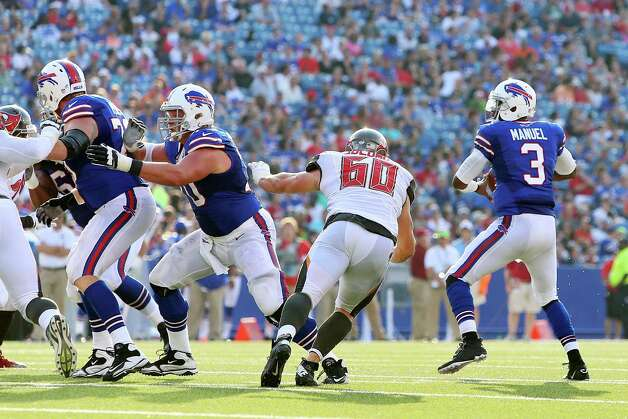 ORCHARD PARK, NY - AUGUST 23: EJ Manuel #3 of the Buffalo Bills throws a touchdown to Mike Williams #19 of the Buffalo Bills against the Tampa Bay Buccaneers during the second half at Ralph Wilson Stadium on August 23, 2014 in Orchard Park, New York. (Photo by Vaughn Ridley/Getty Images) ORG XMIT: 501604729 Photo: Vaughn Ridley / 2014 Getty Images