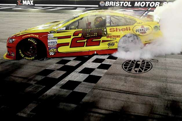 BRISTOL, TN - AUGUST 23:  Joey Logano, driver of the #22 Shell Pennzoil Ford, celebrates with a burnout after winning the NASCAR Sprint Cup Series Irwin Tools Night Race at Bristol Motor Speedway on August 23, 2014 in Bristol, Tennessee.  (Photo by Patrick Smith/Getty Images) ORG XMIT: 464040411 Photo: Patrick Smith / 2014 Getty Images